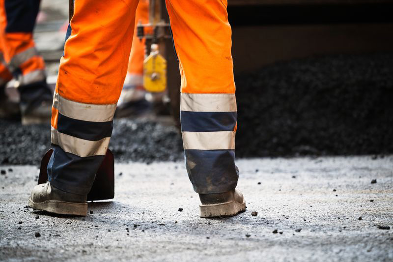 Wedge sole work boots track less debris than lugged work boots