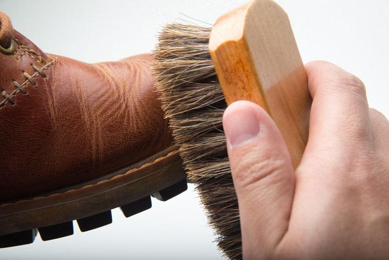 using-horse-hair-brush-on-boots-daily-boot-maintenance.jpg