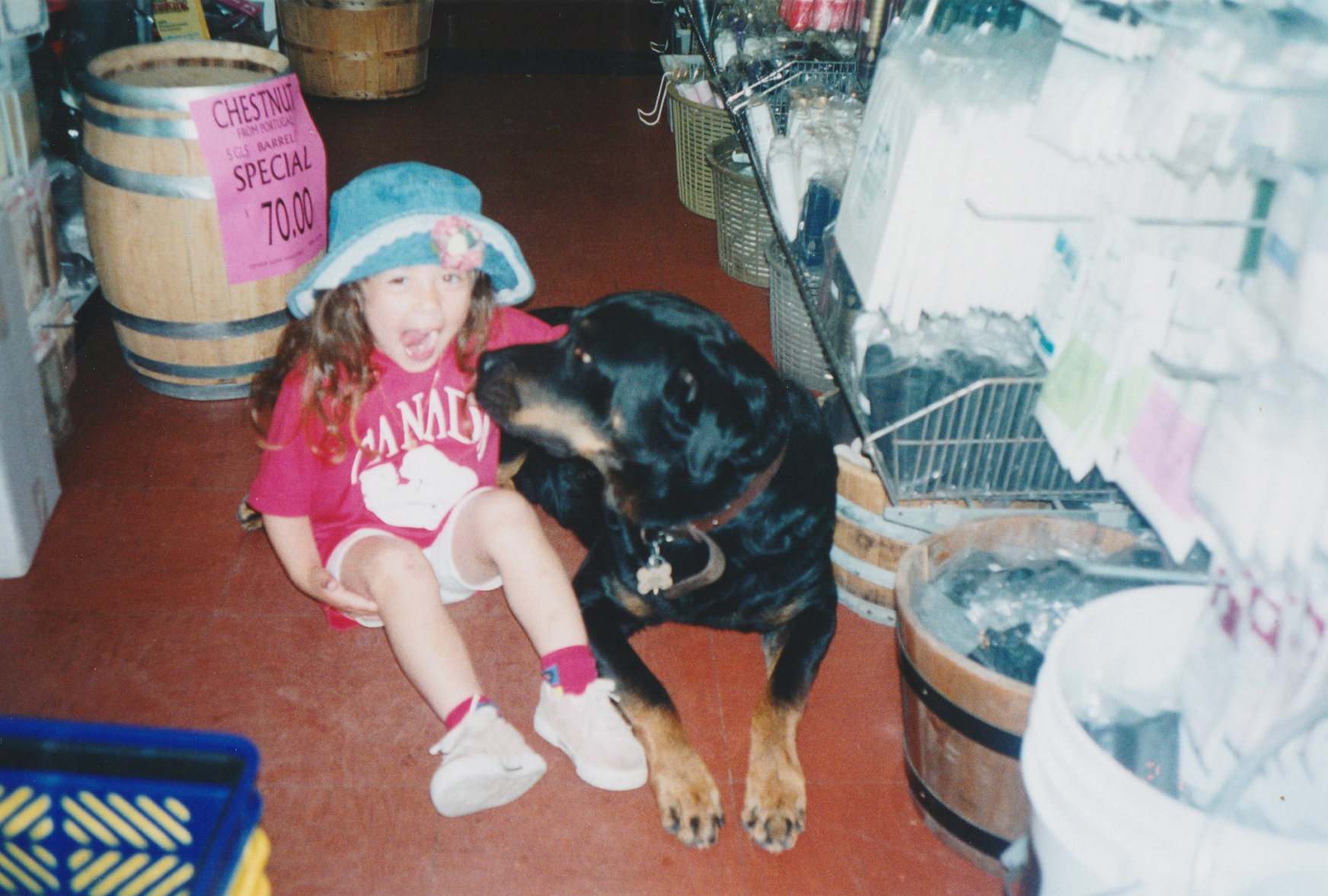 Little ol' me and Mason at my mom's wine shop- where the dogs used to hang out throughout the day