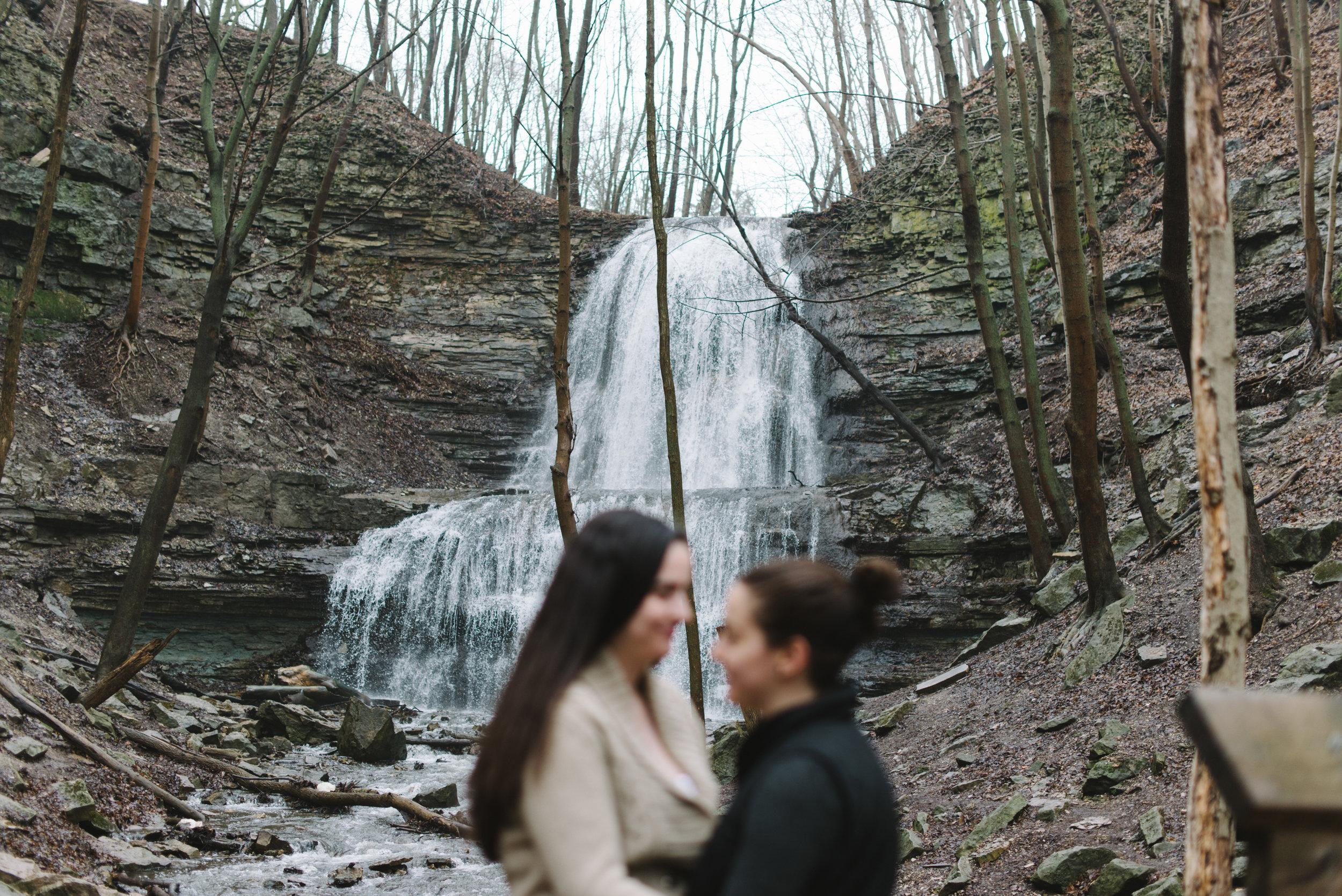 RosewoodWeddingPhotos-TeresaDeanna-EngagementSession-Hamilton-ShermanFalls-Ancaster-Hike-SameSexCouple-LGBTQ-TorontoWeddingPhotographer-Waterfall