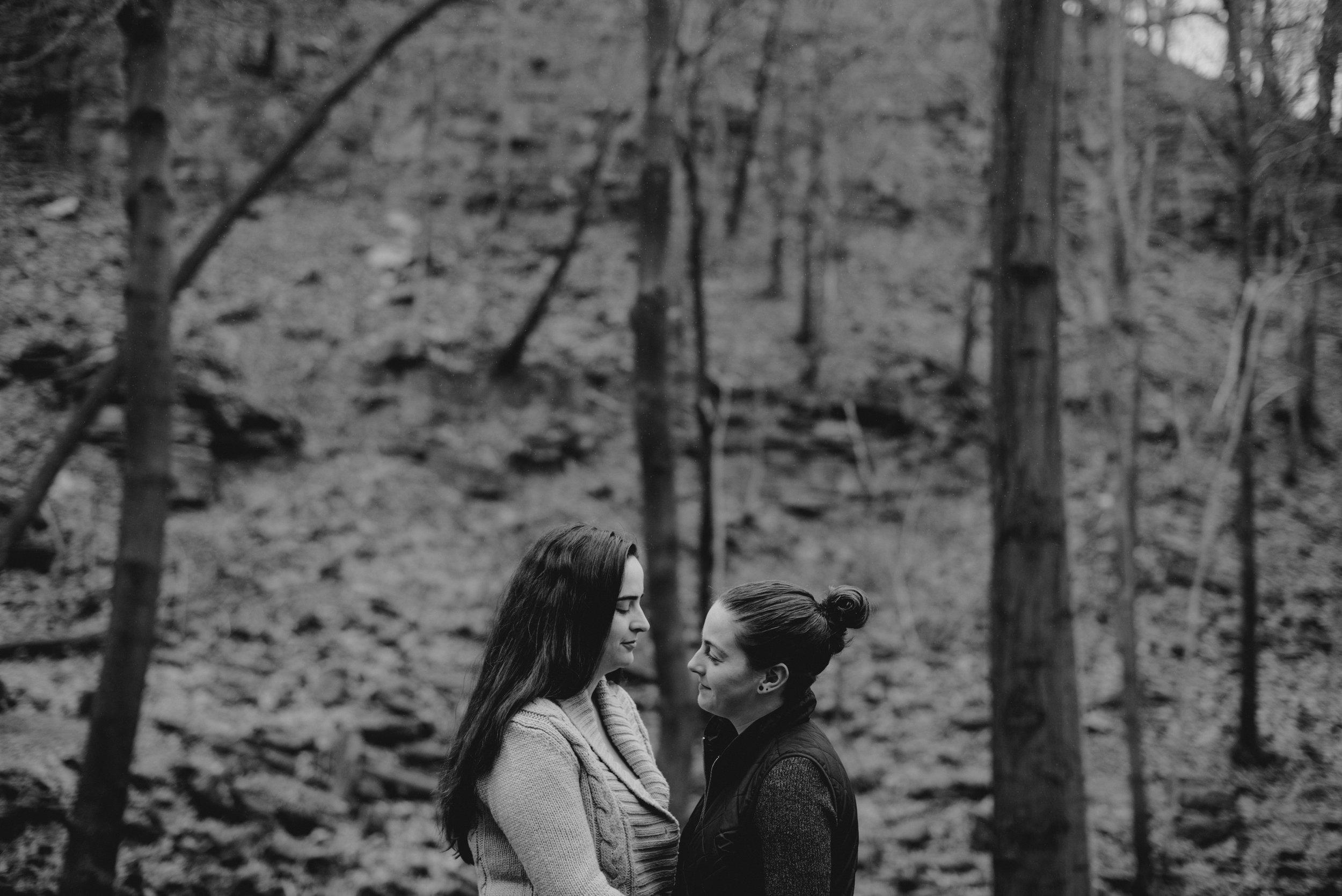 RosewoodWeddingPhotos-TeresaDeanna-EngagementSession-Hamilton-ShermanFalls-Ancaster-Hike-SameSexCouple-LGBTQ-TorontoWeddingPhotographer-BlackandWhite-Waterfall