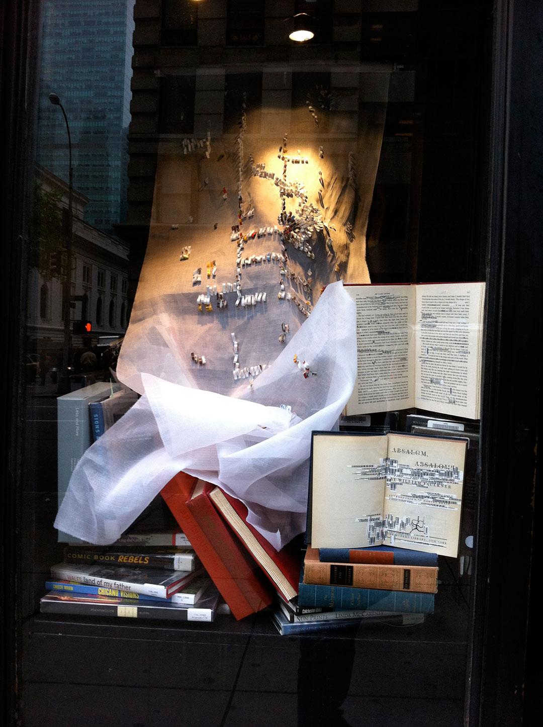 Shredded: Off the Grid, panel 1, installation view at the Manhattan Midown Public Library windows..