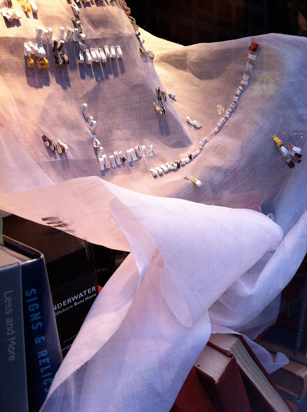 Shredded: Off the Grid, panel 2, installation view at the Manhattan Midown Public Library windows..