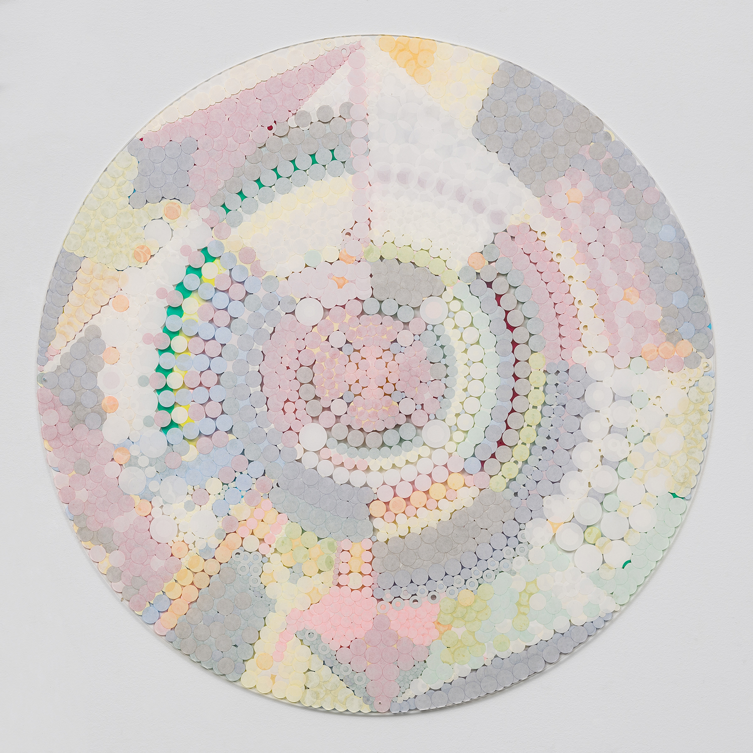 """Fusion Mandala 1,  2011, color coded labels collage on Plexi, 30"""" diameter."""