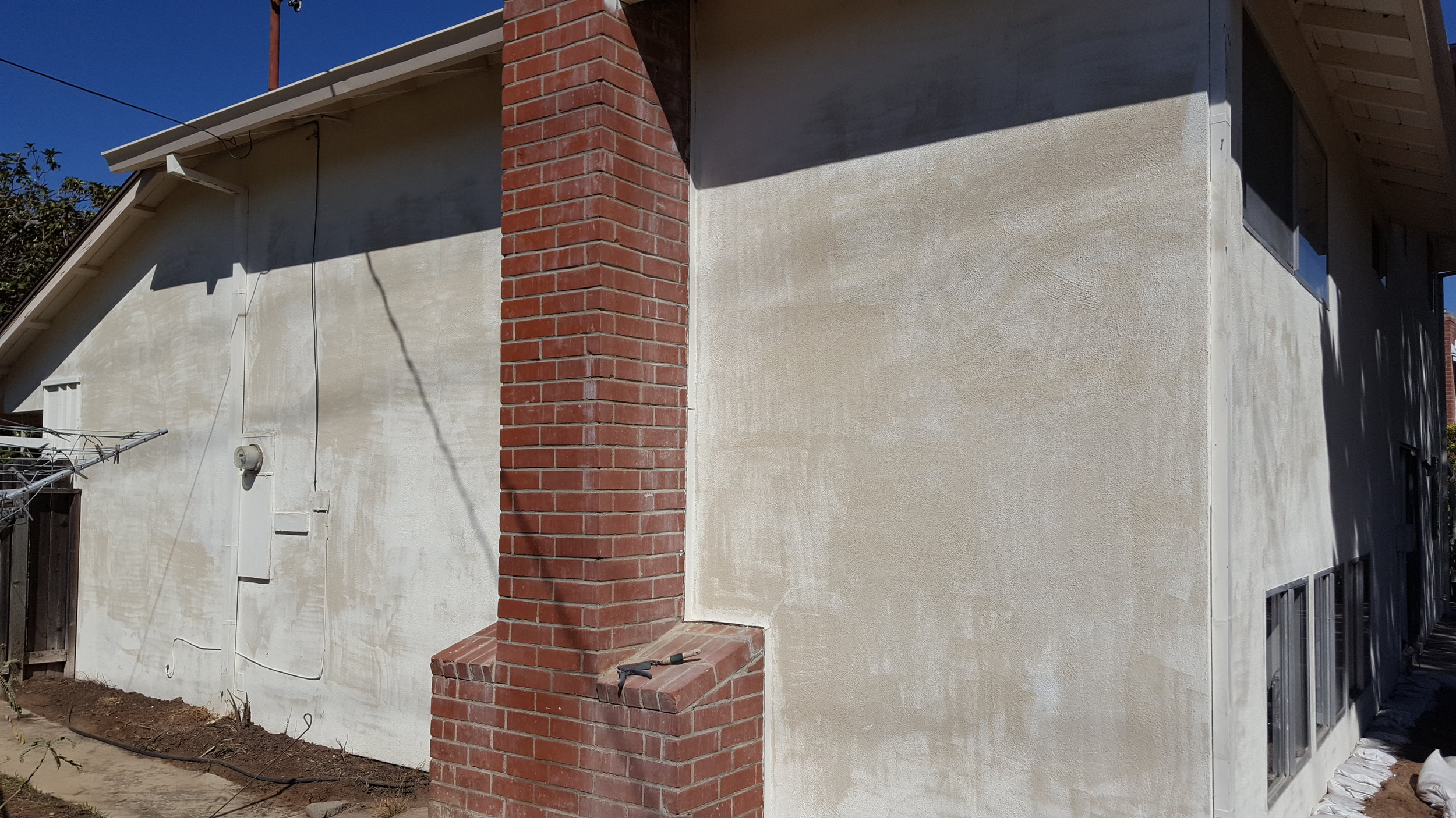 Stucco after pressure washing: ready to prime and paint!