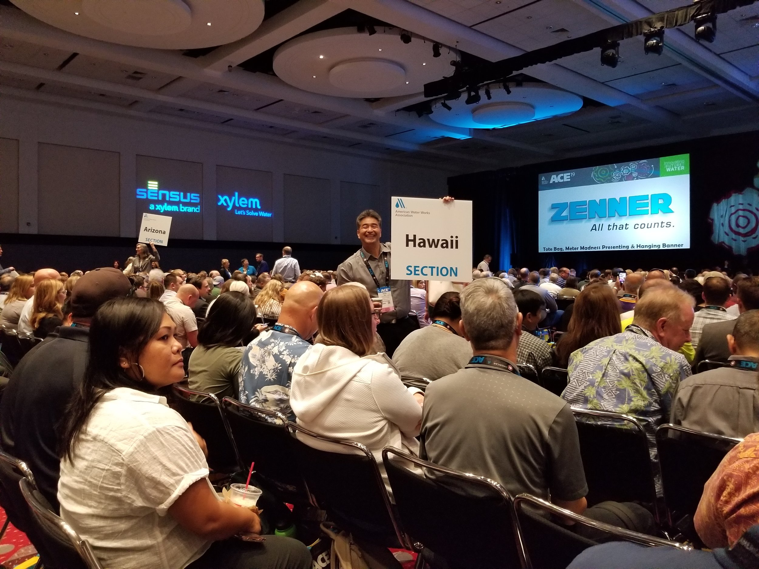 Hawaii Section Chair Kevin Ihu holds the Hawaii Section sign for the ACE19 Opening General Session on 6/10/2019.