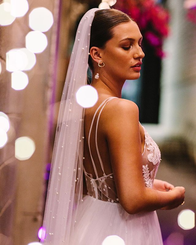 Glittery lights ✨ shot of the stunning @ellagreen_555 of @rebelrebeltalent for @theweddingharvest in this stunning gown and veil from @oscarandivybridal . Hair and makeup @blushandbangsbeauty & @peach_industries .