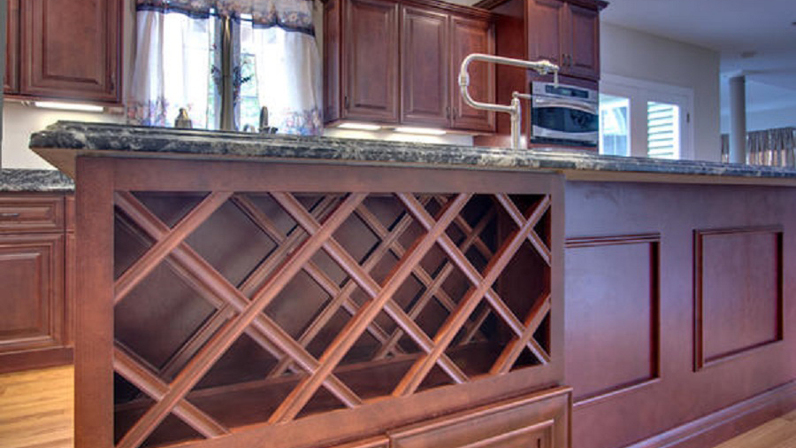 J5_Red_mahogany_stained_maple_wood_cabinets_in_a_refined_traditional_style_wine_rack.jpg