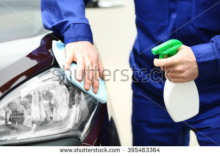 stock-photo-young-man-cleaning-car-lights-395463364.jpg