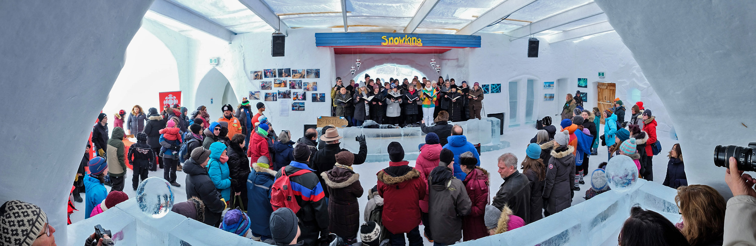 Spiritus performs a short program as they squeeze their way on stage in the Snow Castle surrounded by onlookers. This definitely qualifies as the top three of the most unusual venues the choir has ever performed in.
