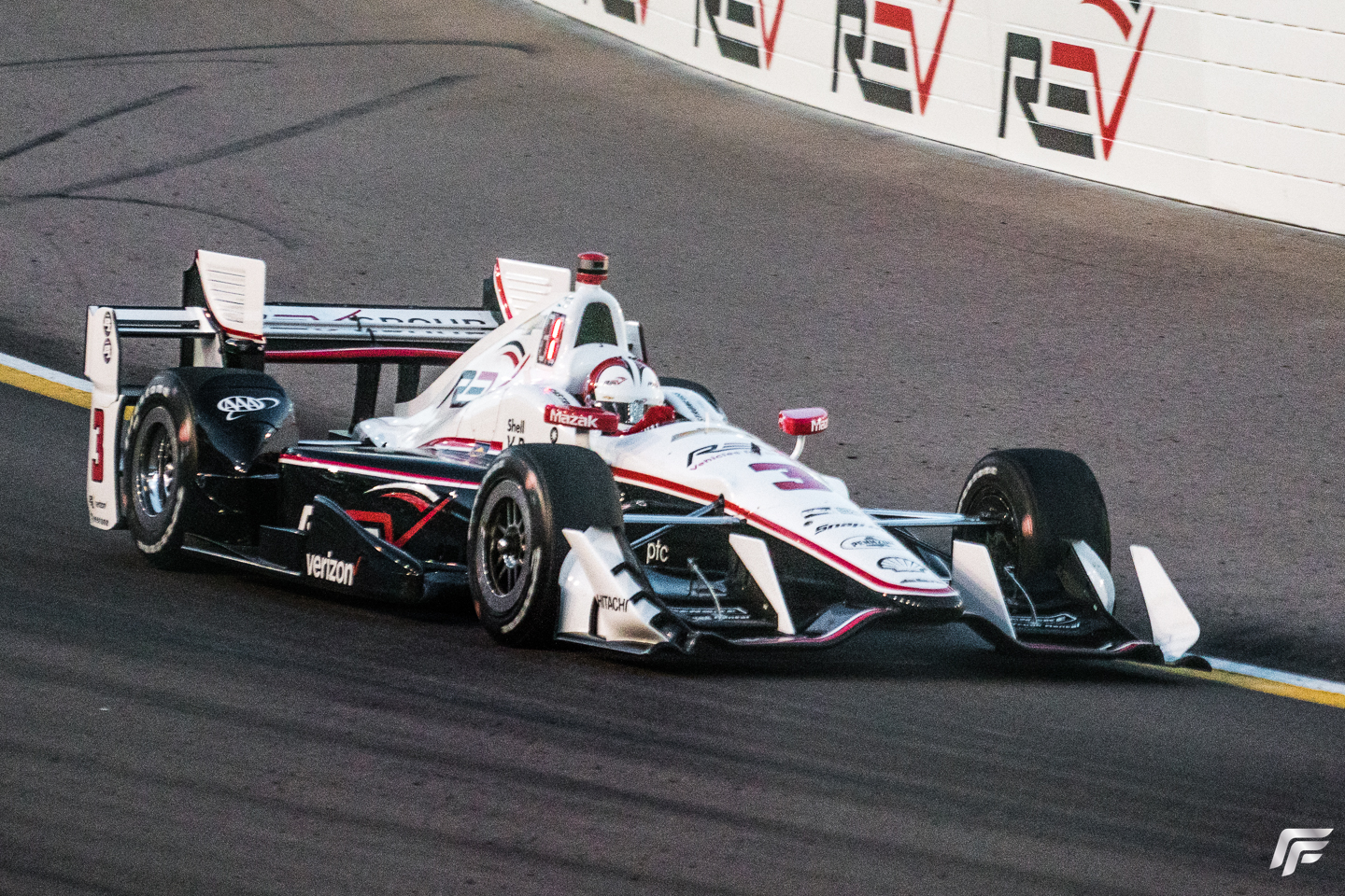 As the sun begins to set over the evening race pole-sitter Helio Castroneves leads the field.
