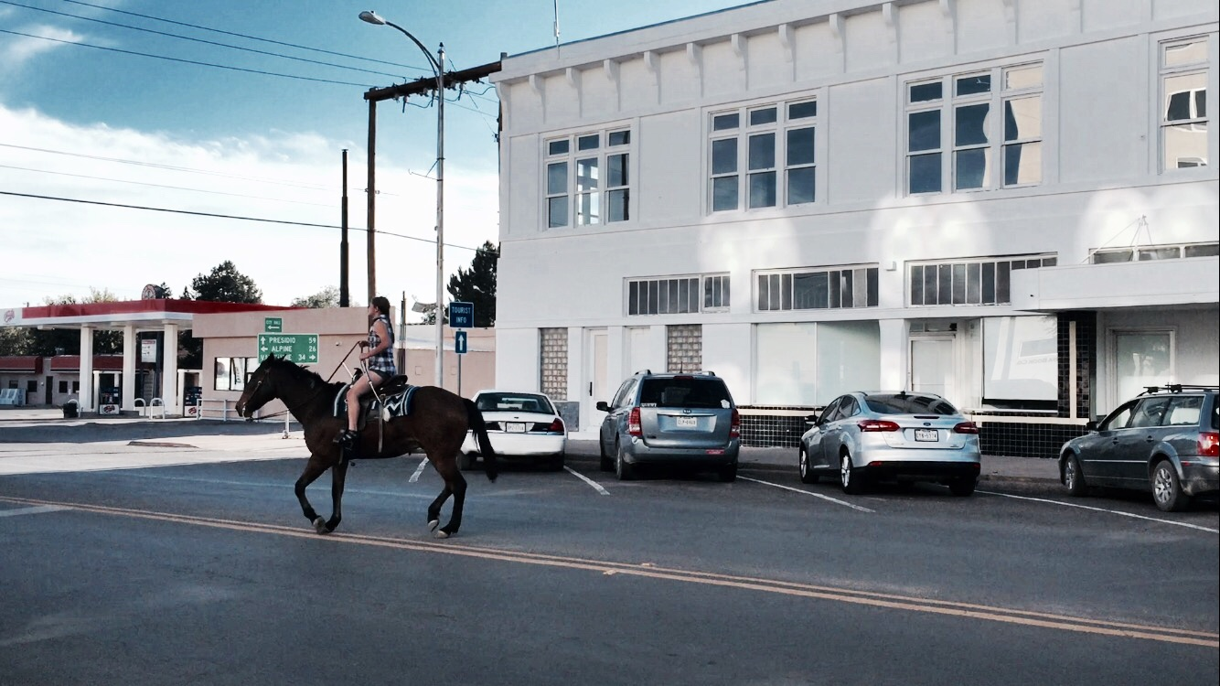 Transportation by horse in the middle of town....If this isn't quintessential Texas, I don't know what is.