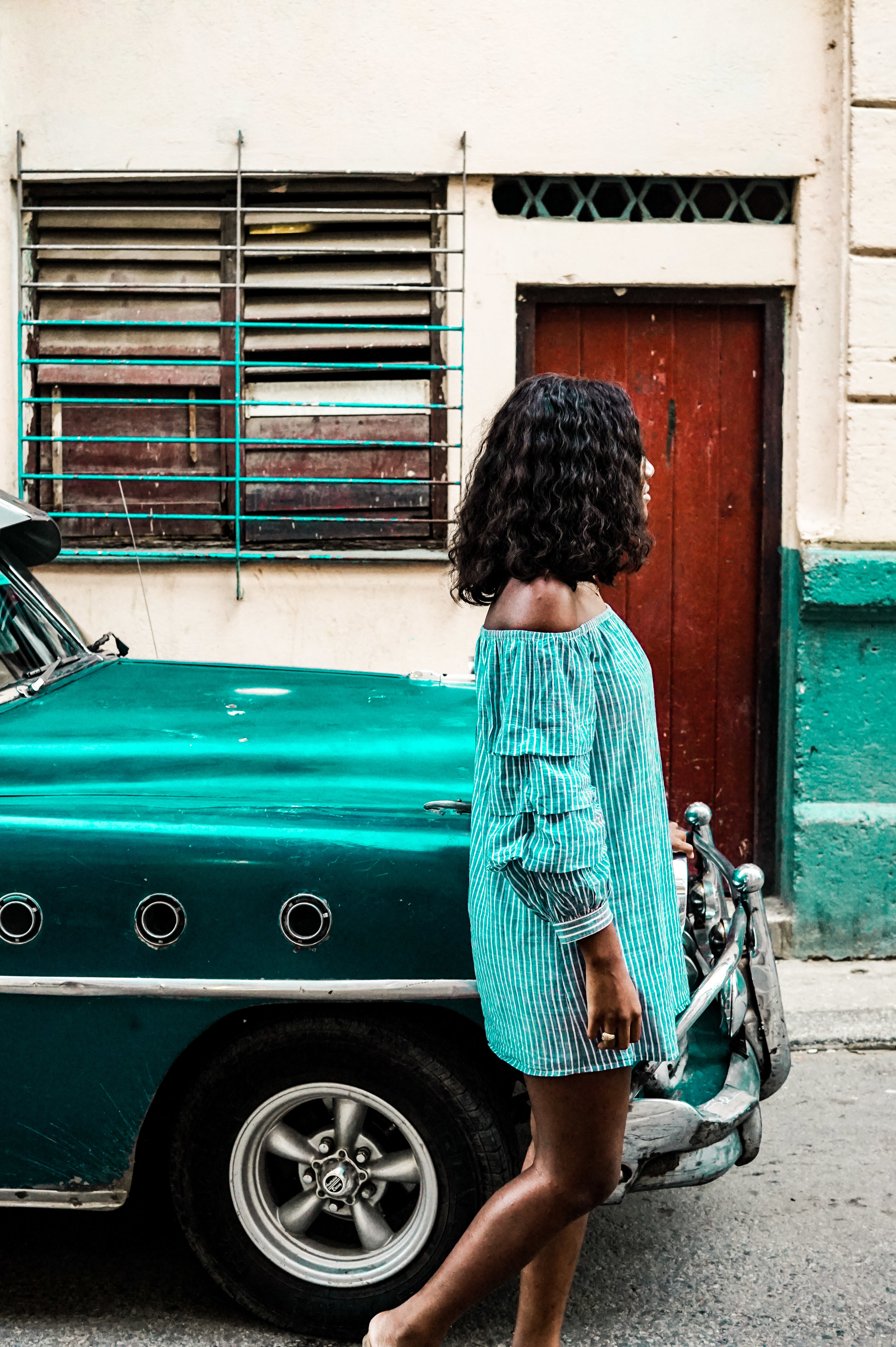 """On my final day in Cuba, a local boy asked if he could take me on a tour of Havana - he wanted to earn some extra money! I initially declined, then thought, """"why not?"""". I learned so much about Cuba during our city walk and he snapped this photo of me!"""