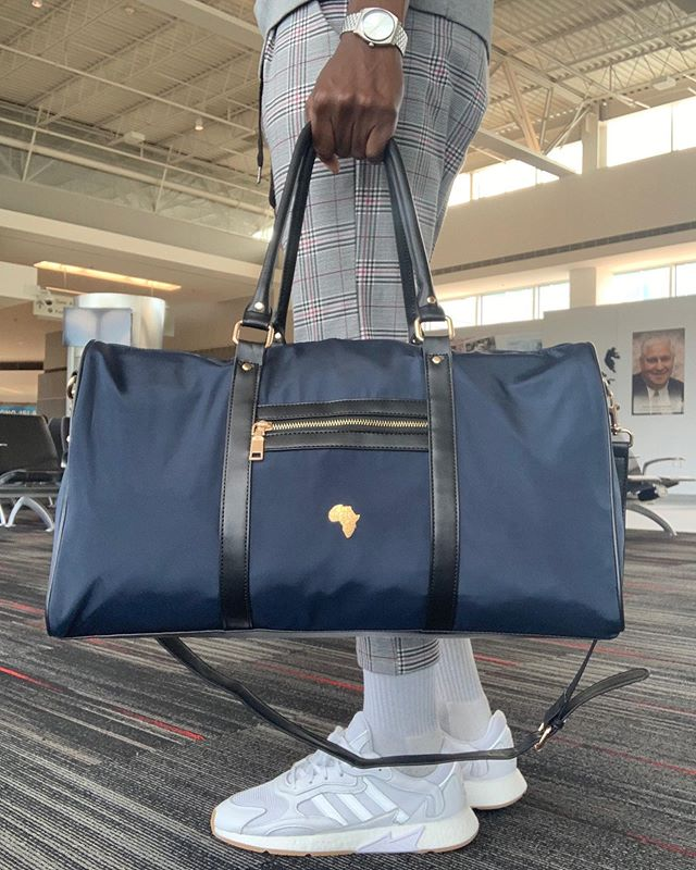 🧳 NxN Gold Africa Duffle - Available in Black, Wine, Olive, Tan, and Navy! 🌍 NxNworldwide.com - - - - - #Travel #Worldwide #Adventure #Vacation #Africa #Explore #TravelBlog #TravelBlogger #Passport #Tourism #TravelTheWorld #BlackExcellence #SeeTheWorld #Culture #TravelEssentials #BlackTravelers #BlackTravel #BlackTravelFeed #BlackTravelMovement #TravelNoire