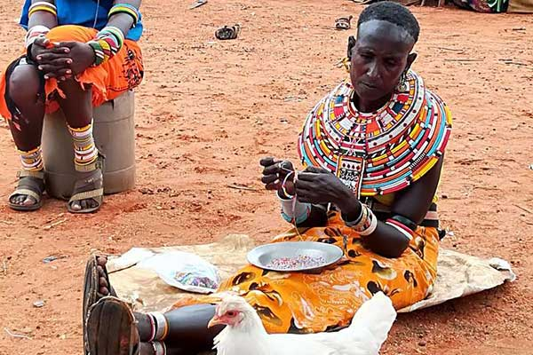 A Samburu woman makes ornaments using beads. Women from nine community  conservancies in Samburu Laikipia, Isiolo and Marsabit counties are  making necklaces for sale under the sponsorship of Northern Rangelands  Trust. PHOTO | FILE | NATION MEDIA GROUP
