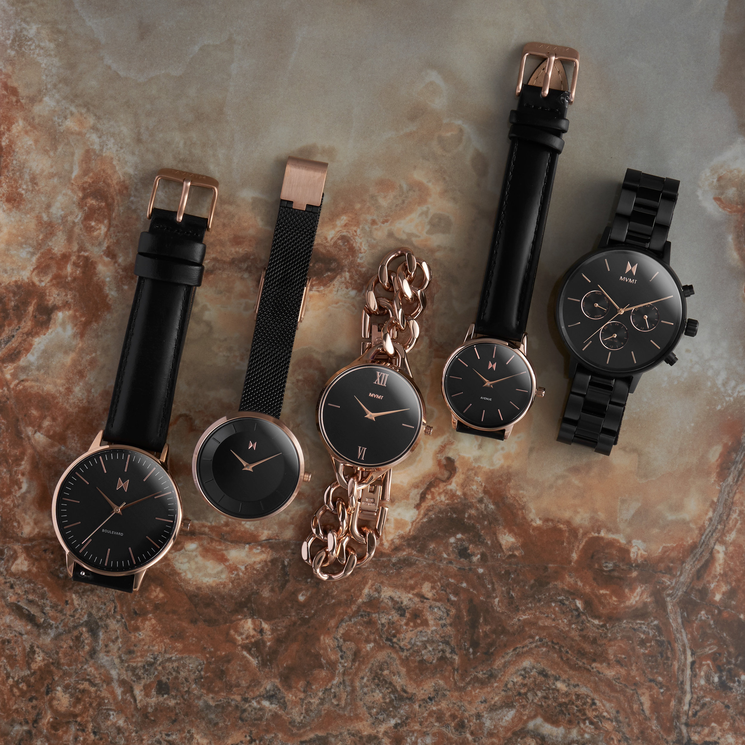 Group Black watch with rose gold accent spread.jpg