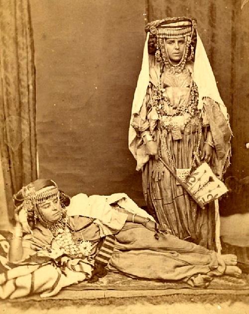 "by Auguste Maure, 1875 <u><a href=""https://commons.wikimedia.org/wiki/File:Auguste_MAURE-Femmes_Algeriennes.JPG"">via</a></u> Wikimedia Commons"