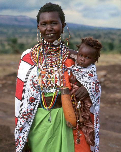 """By Jack-z <u><a href=""""https://en.wikipedia.org/wiki/File:Maasai_Woman_Meeyu_Sale_Wearing_her_Finest.jpg"""">via</a></u> Wikimedia Commons"""