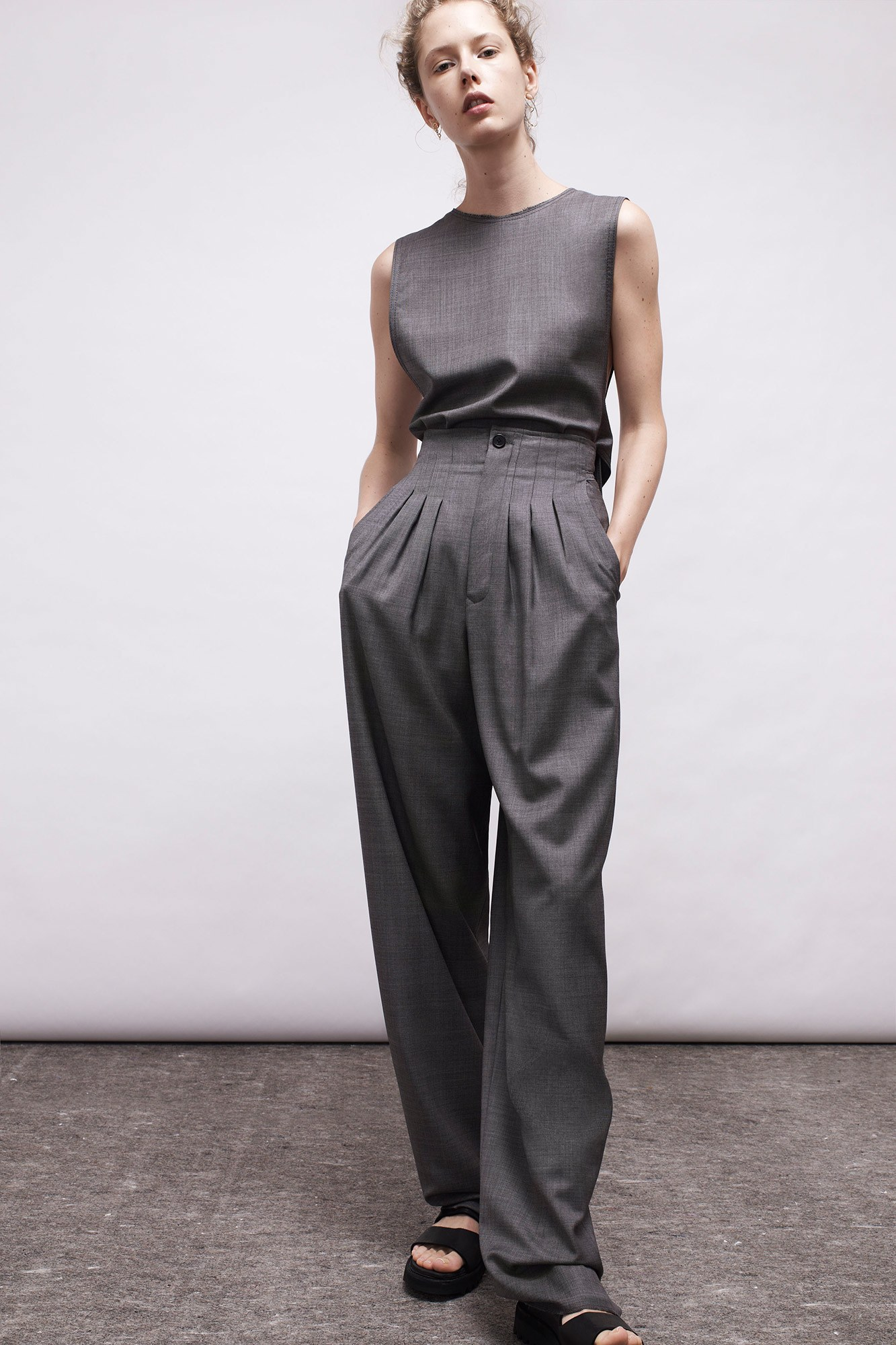 A monochromatic gray look with pleated high waist pants