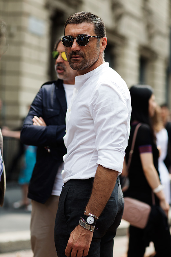 This is one of the most standard combinations imaginable: black pants and a crisp white shirt, but attention to fit and proportion makes it exceptional. Takeaway: find a tailor; put on speedial.  Via  The Sartorialist
