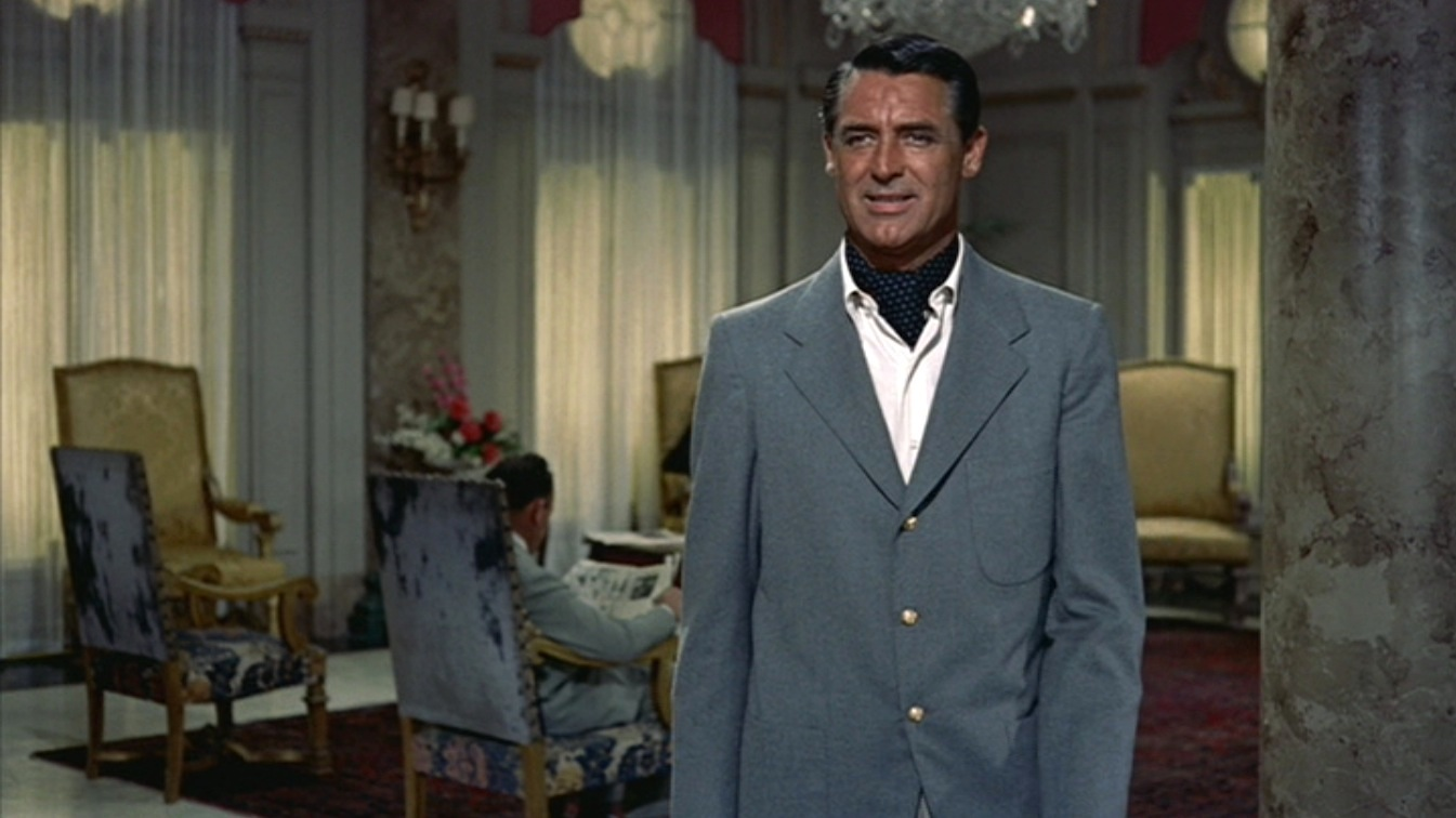 Stop it, Cary. Here, also in To Catch A Thief, a subtle white dot on a black silk ascot makes him even more irresistible to an equally irresistible Grace Kelly.