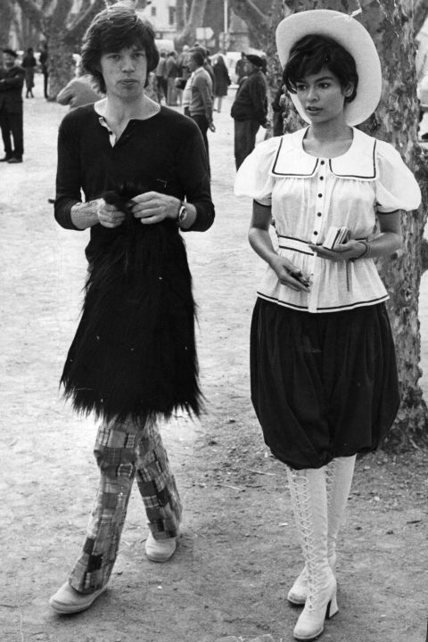 Wearing a skirt, with Bianca Jagger. Photo:  Reg Lancaster on Getty Images.