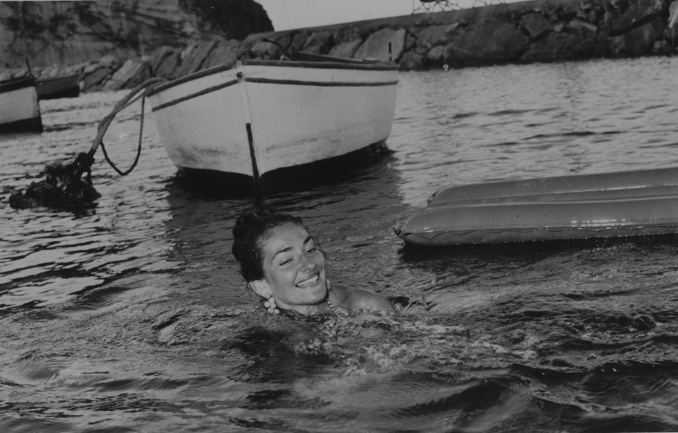 Swimming in Ischia, 1958. Photo:AP/AP/SIPA. (ps. there is a 100% chance I'm swimming with chandelier earrings on my next time in the sea!)