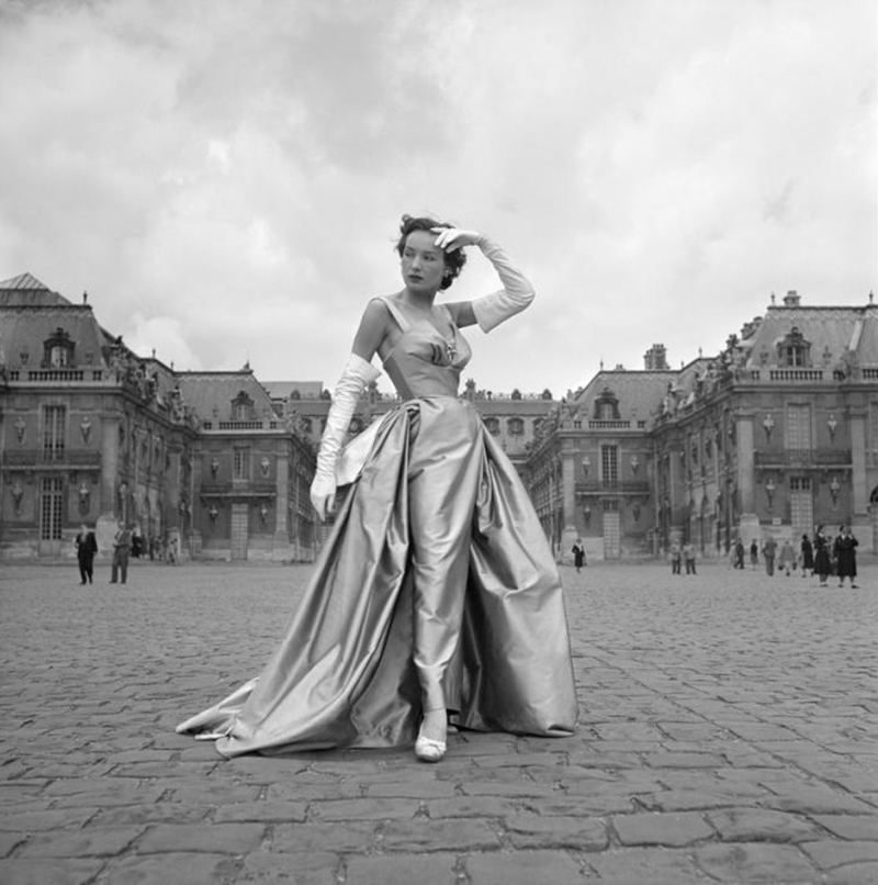 A model wears Dior in Paris, 1951. Photograph by Willy Maywald.