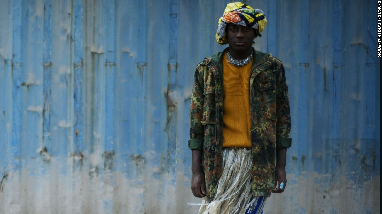 Here, a military jacket is juxtaposed against a grass skirt, contrasting hardness and softness. He adds further interest by incorporating traditionally female accessories- an African head wrap and necklace.