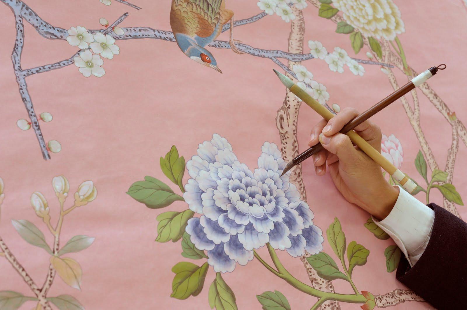 An artisan hand-painting a de Gournay panel