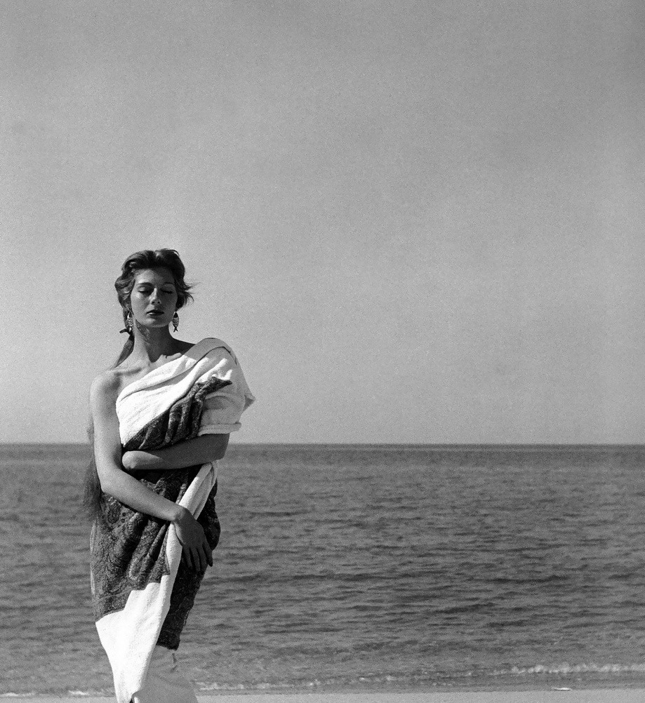 Fiona Campbell-Walter wearing a Givenchy towel in Corsica, 1954. Photo by Georges Dambier.
