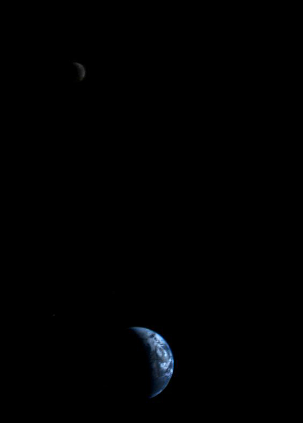 The earth and the moon, captured on September 18, 1977 by NASA Voyager 1 at a distance of 7.25 million miles away from earth. Image  via  the Jet Propulsion Laboratory at the California Institute of Technology.