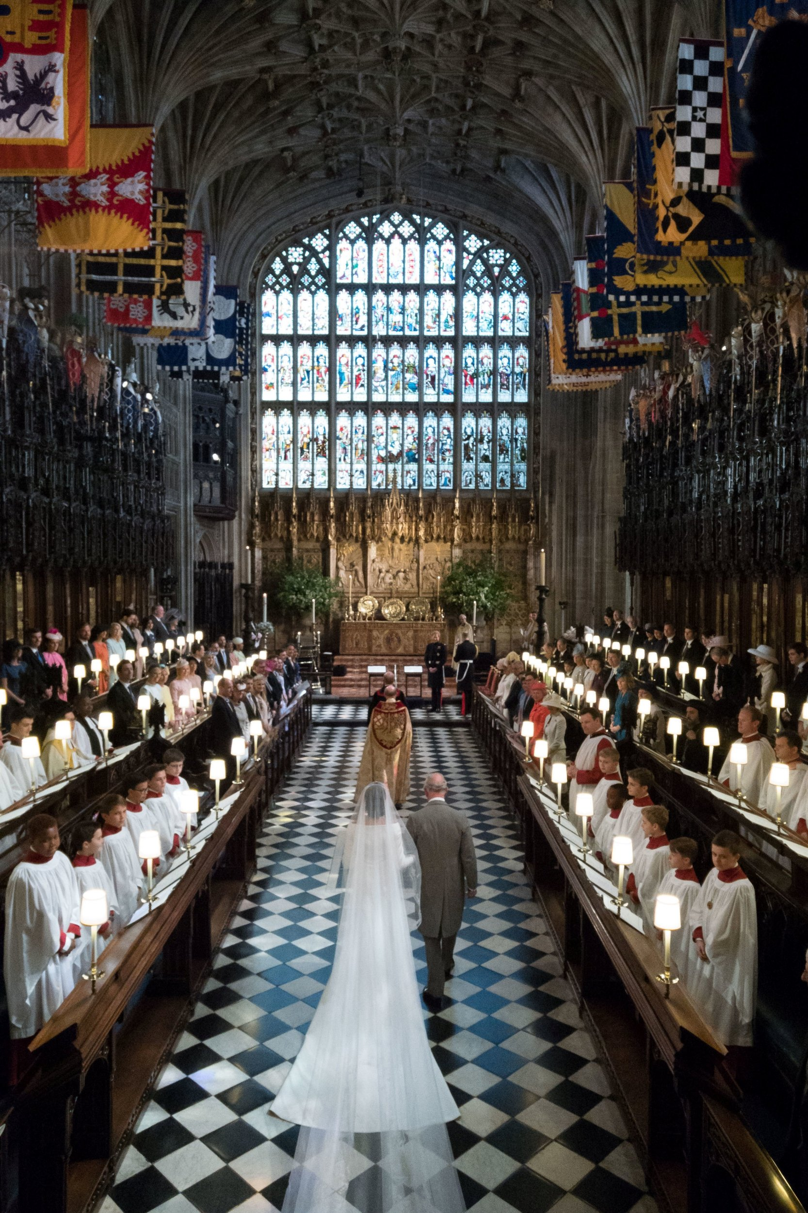 Escorted by Prince Charles to the altar