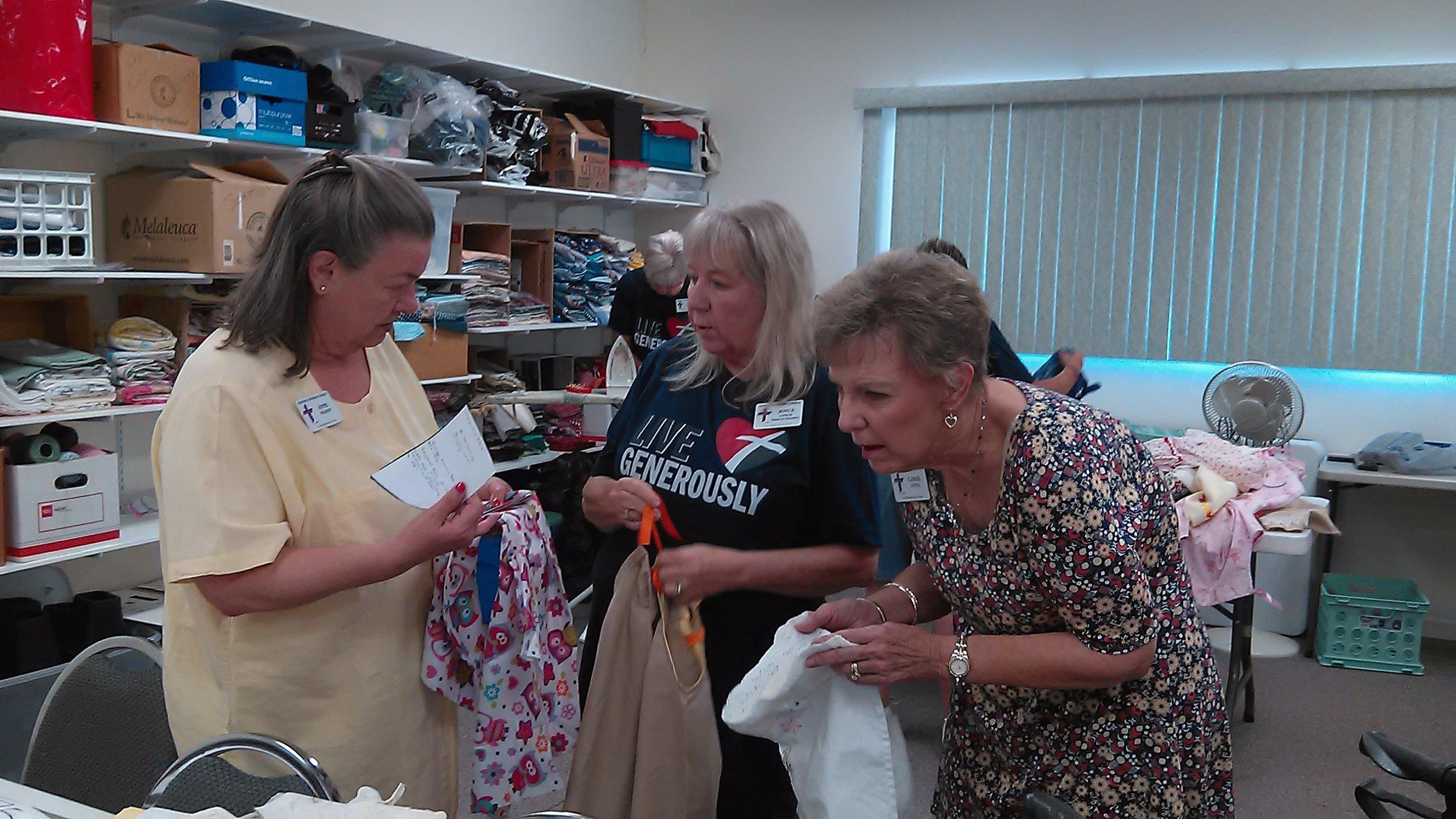 Anne, Joyce, & Carol D picking their dresses.jpg