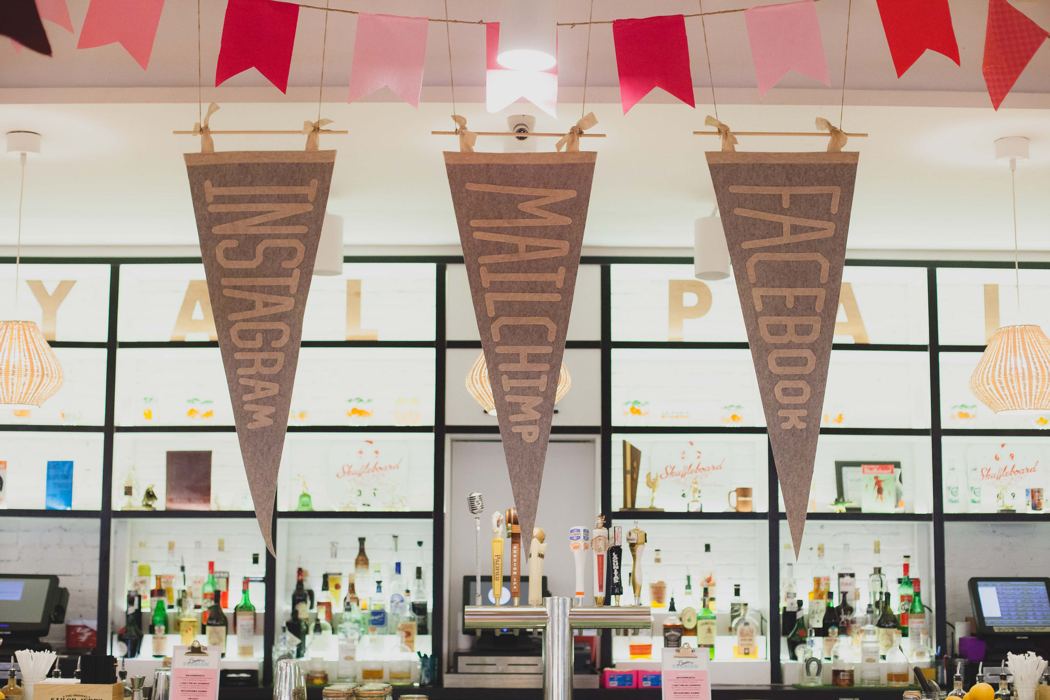 Large, handmade pennants by Small City Supply bring an extra layer of sponsor love to Brooklyn Beta Reunion at Royal Palms Shuffleboard Club.
