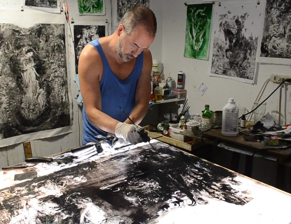 Simon Shawn Andrews working in his studio
