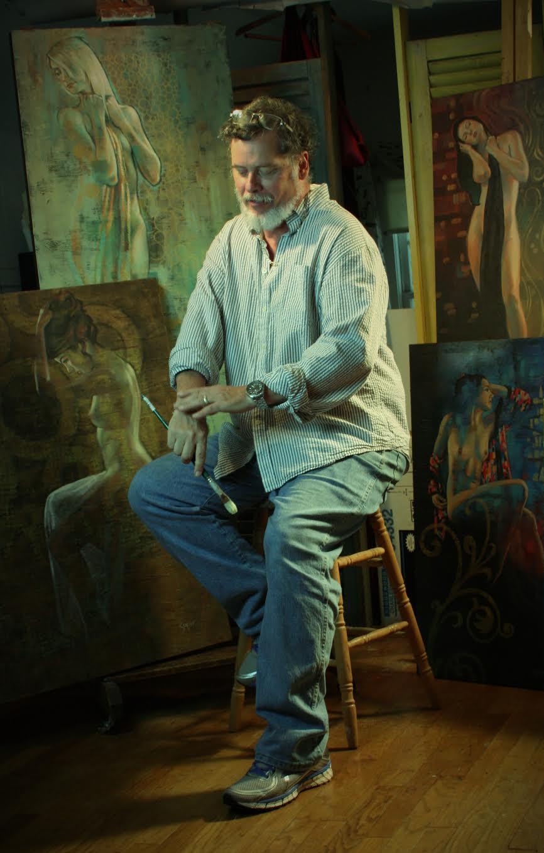 Patrick Soper posing with his paintings