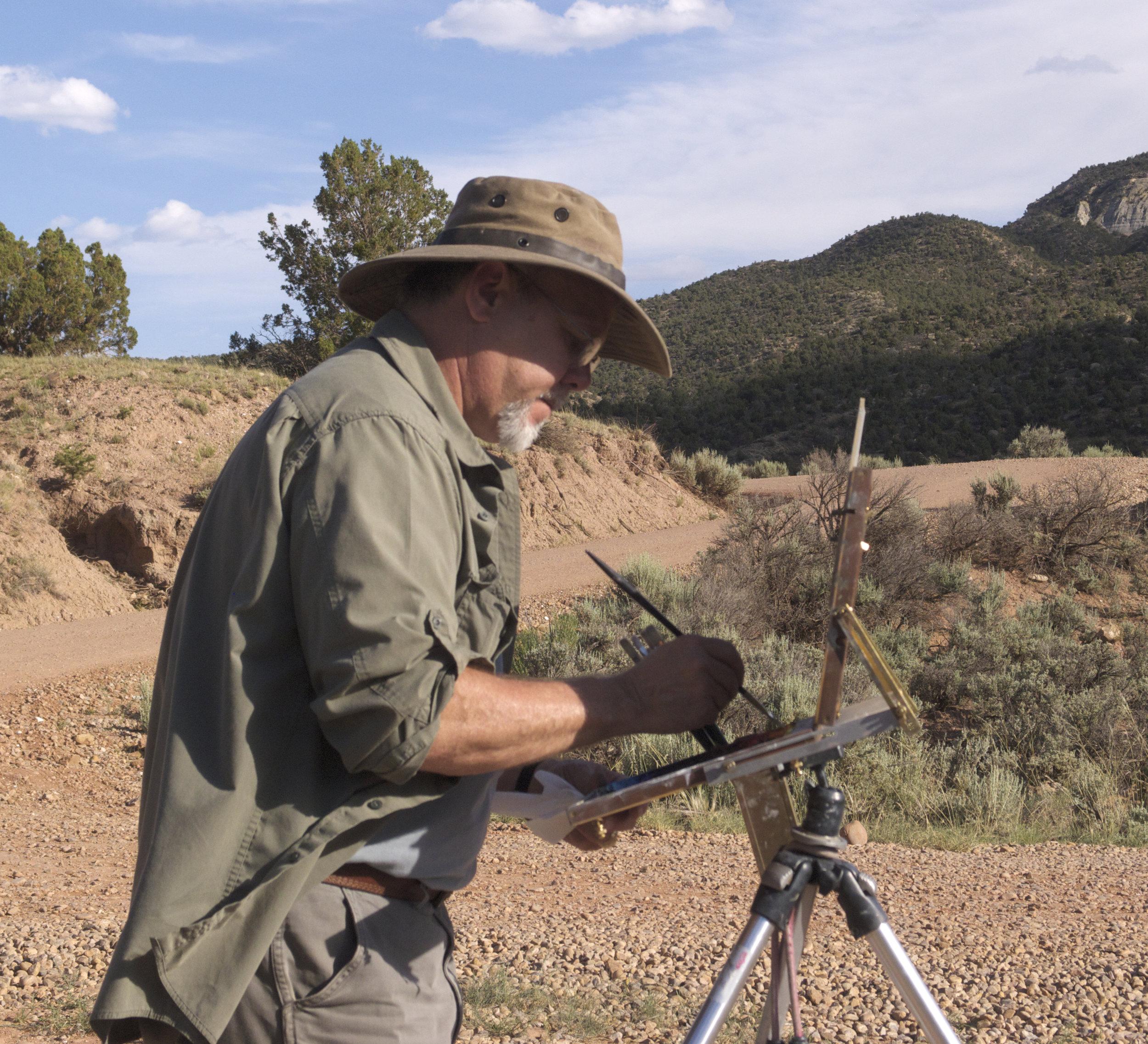 New artist Richard Prather painting outdoors.