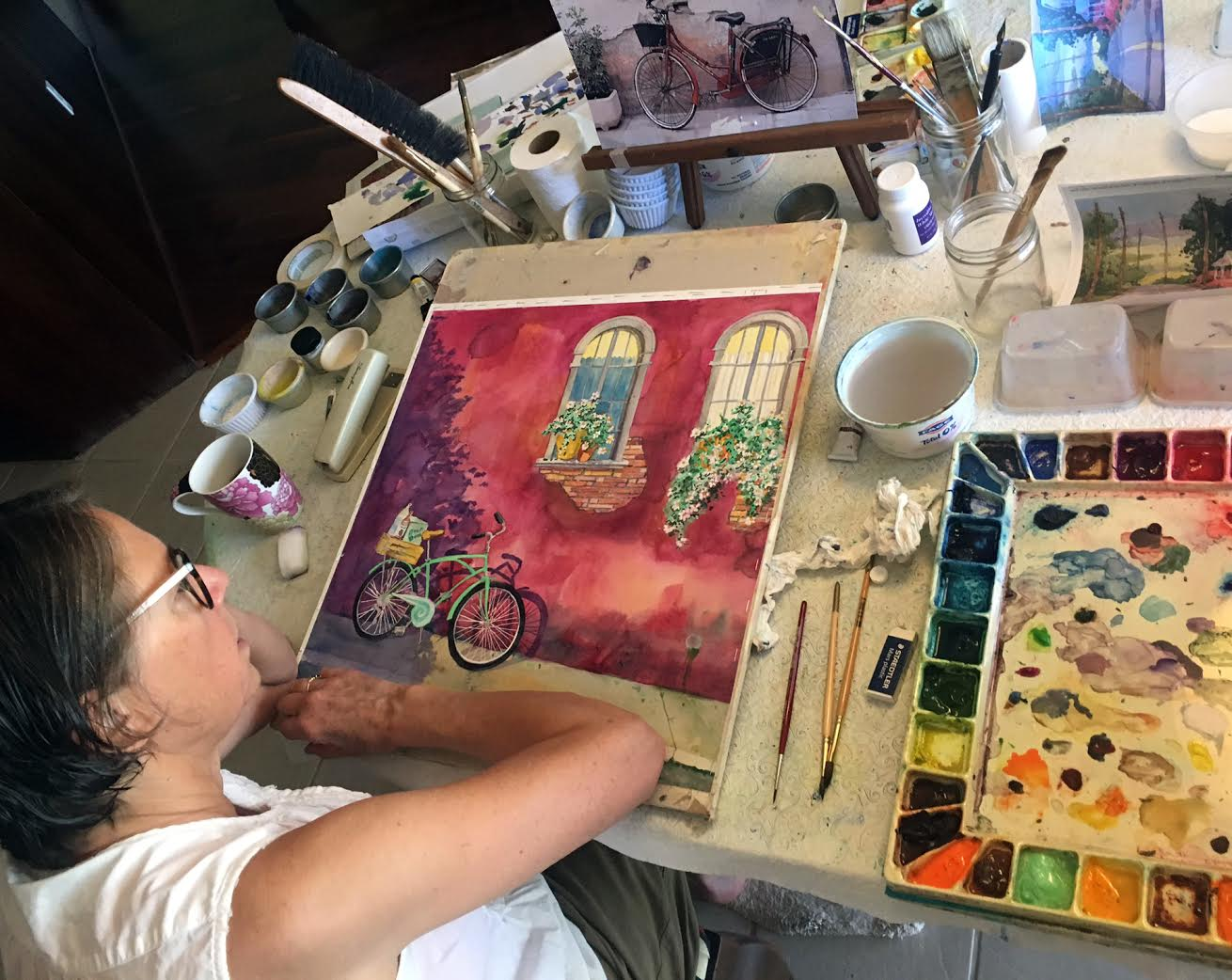 Nancy Muren  in her studio working on watercolor painting,   Shopping in Style