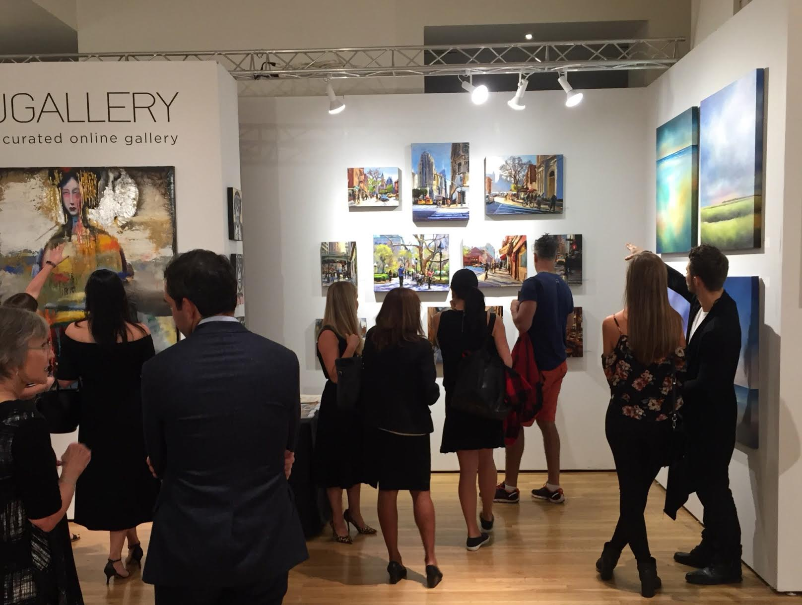 UGallery's featured booth at the entrance of the fair on opening night.
