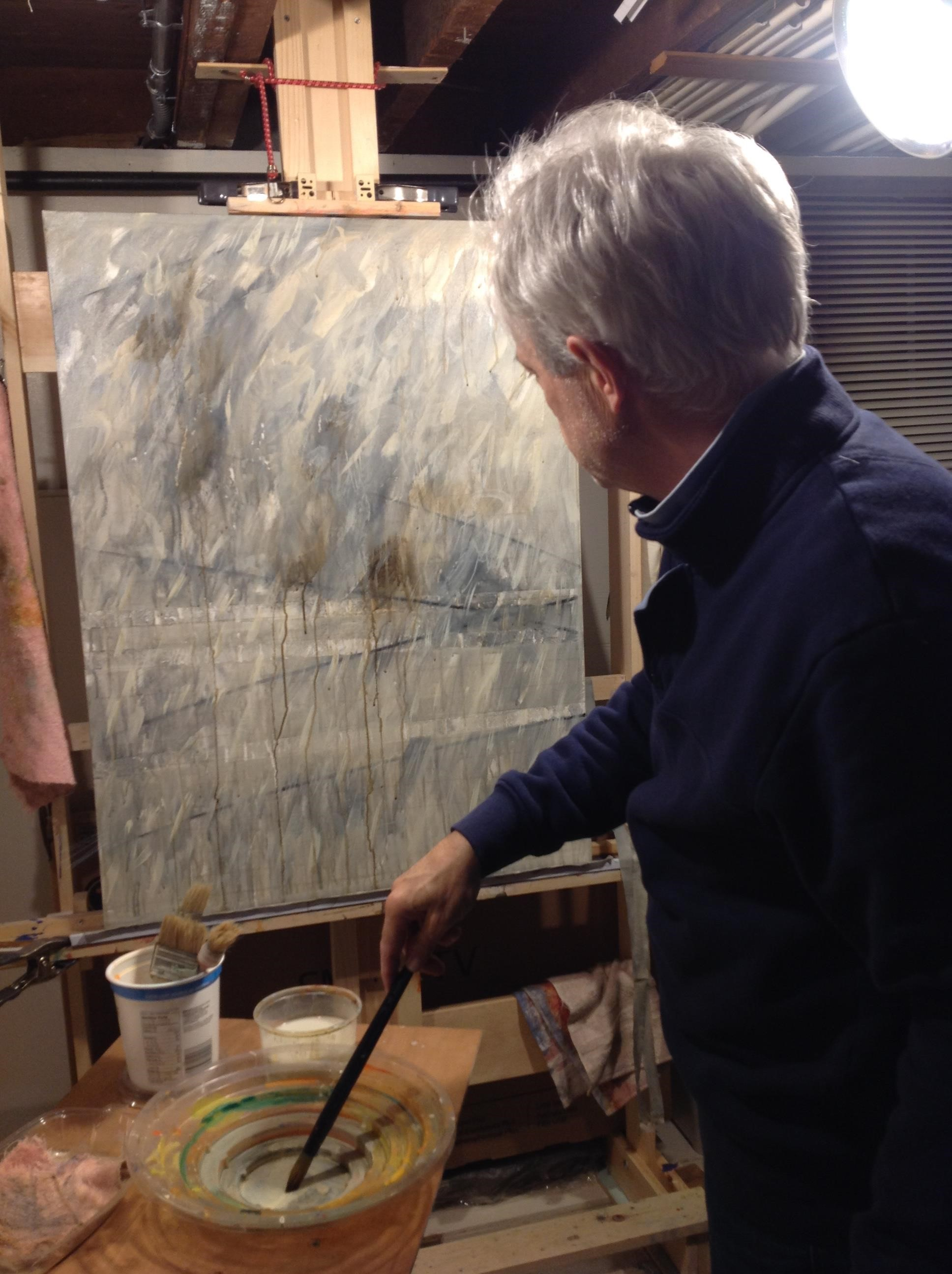 New artist, Ron Fortier working on a painting