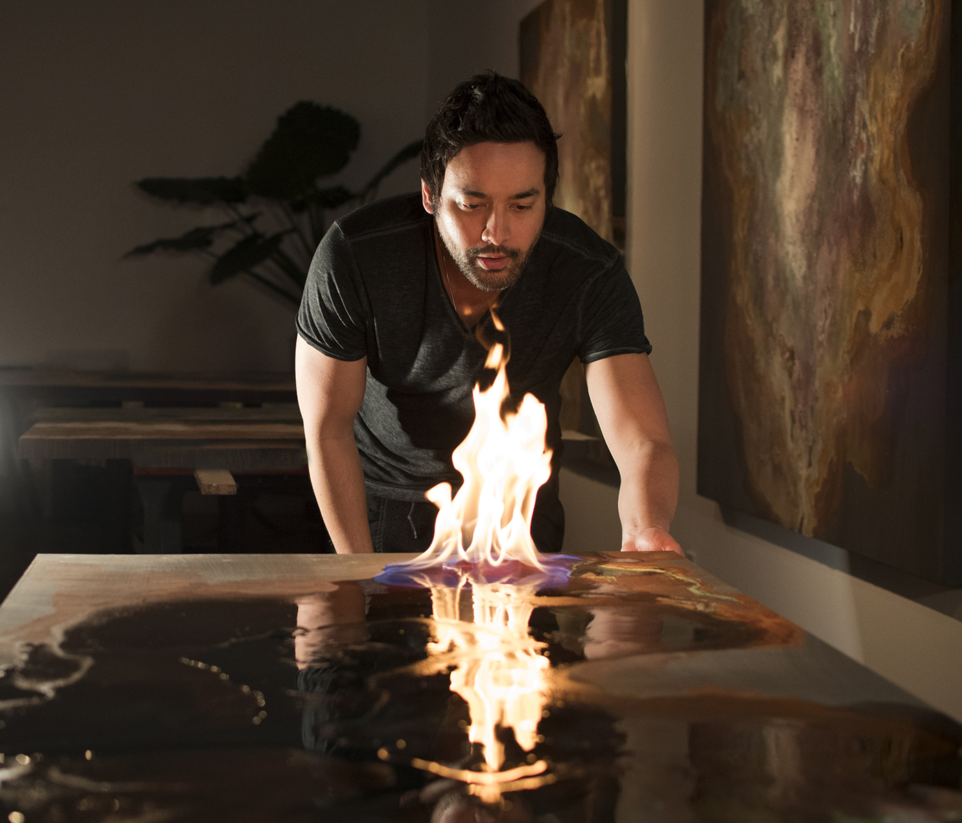 New UGallery artist Tobias Tovera using fire to create his artwork in his studio.