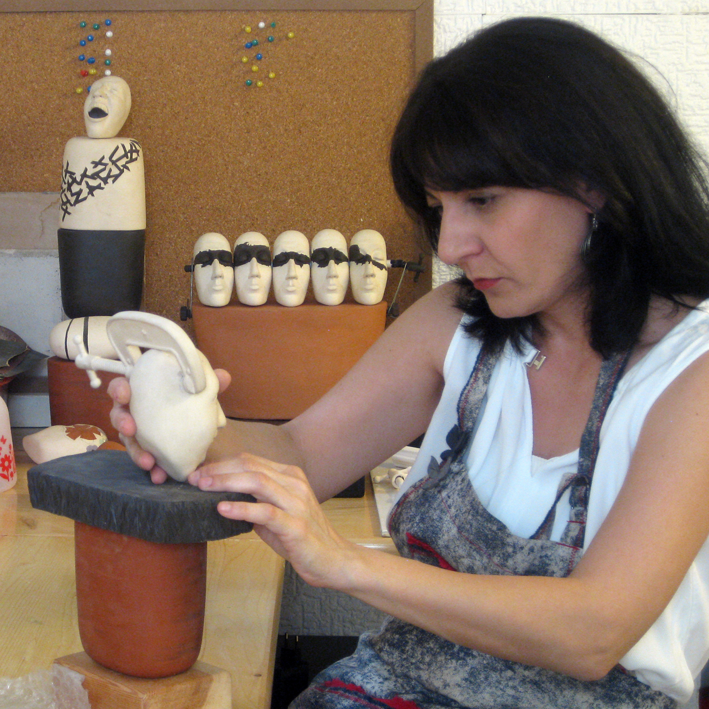 Bahar Ari Dellenbach  working on ceramics in her studio.