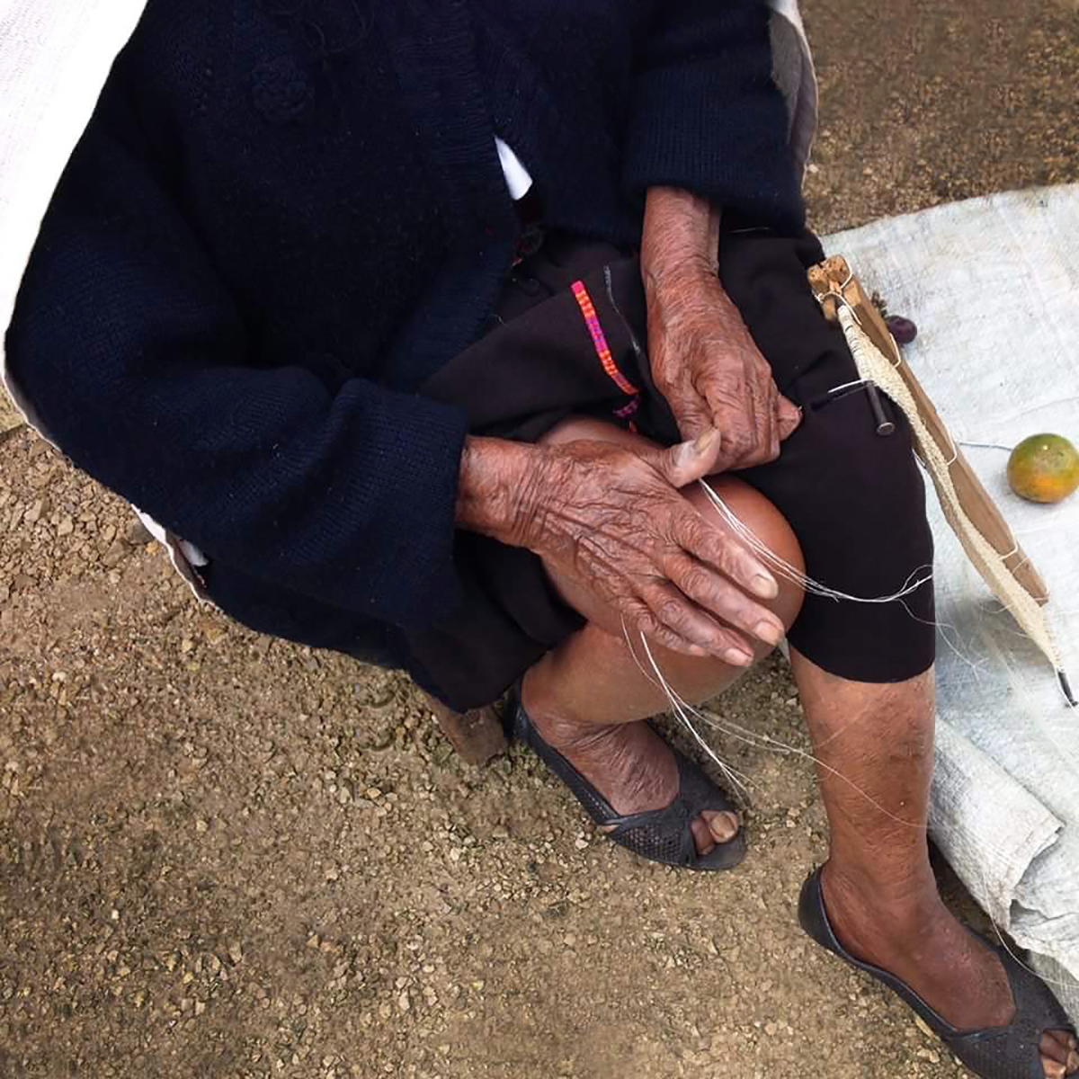 Photo of our 92 years old artisan partner weaving