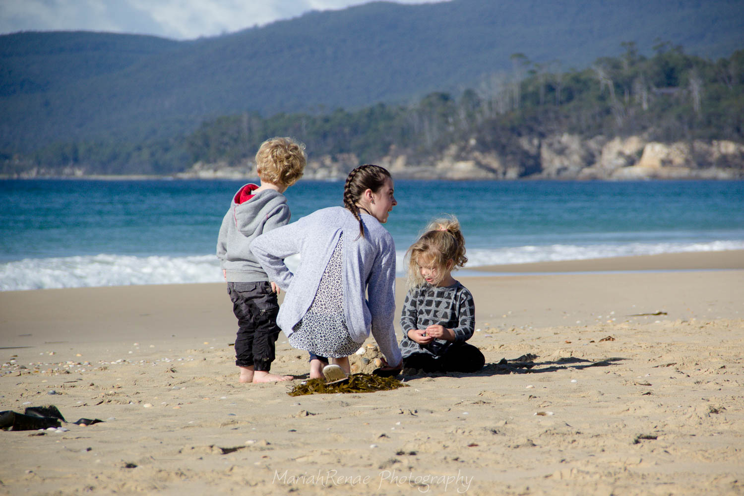 This was a family with two young kids enjoying one of the beaches we visited on the island. The kids were so cute playing in the sand and chasing each other about.