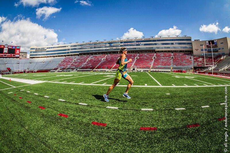 Woman training for triathlon in a stadium