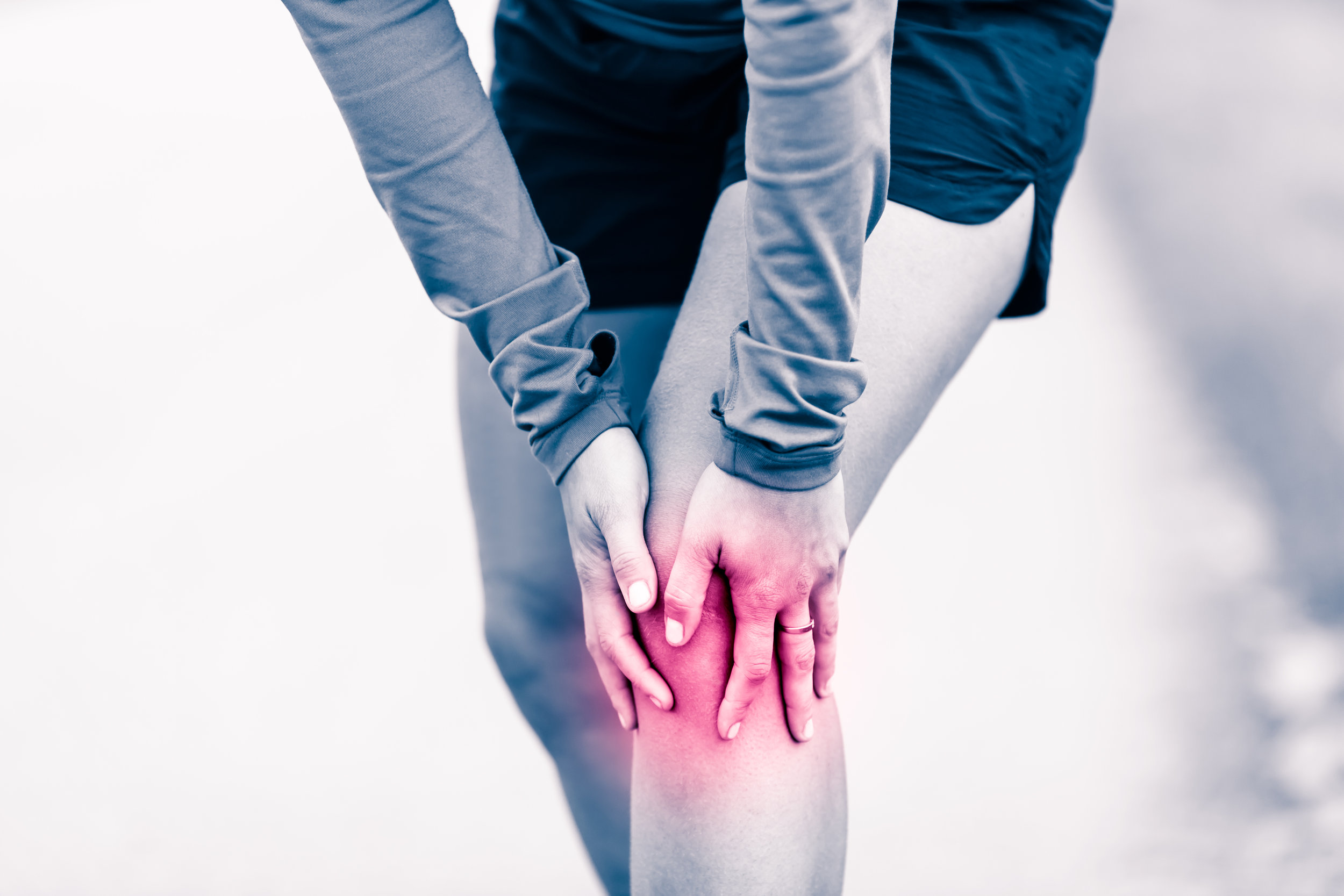 Knee-Pain-Woman-Holding-Sore.jpg