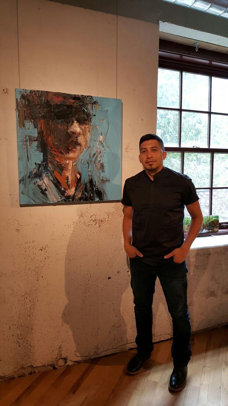 Abstract portraits in display in dual art gallery show at Bartlett Gallery in Canada