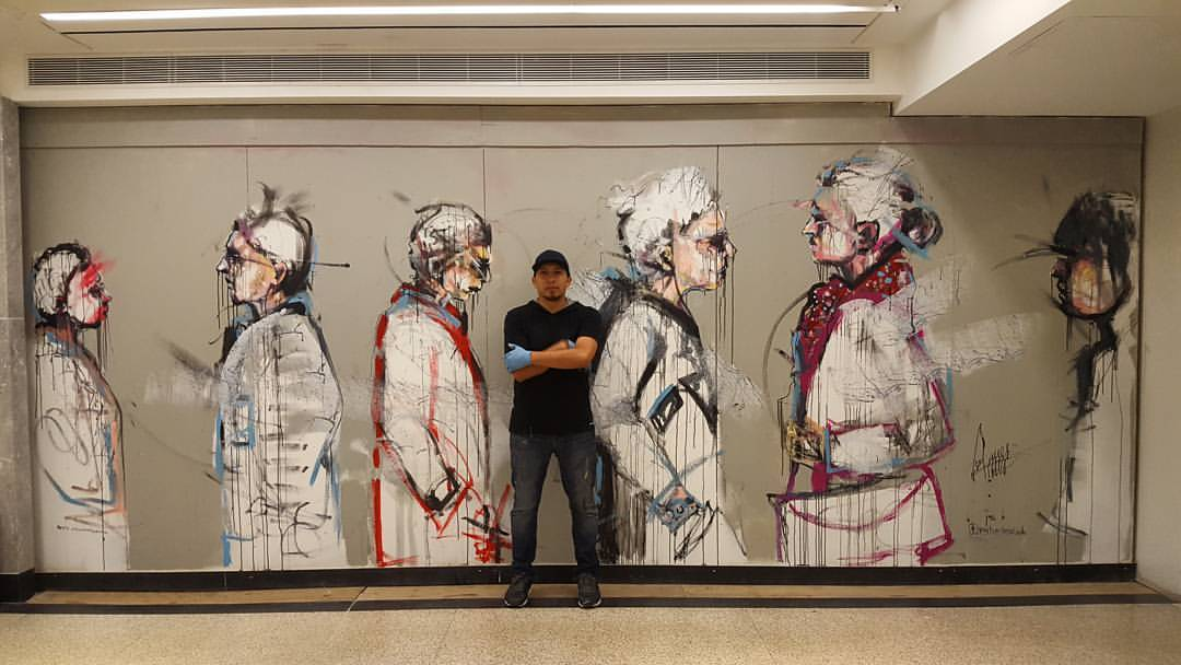 Visual mural artist Carlos Delgado with his finished mural for Ontario Culture Days opening at Union Station train terminal in Toronto.
