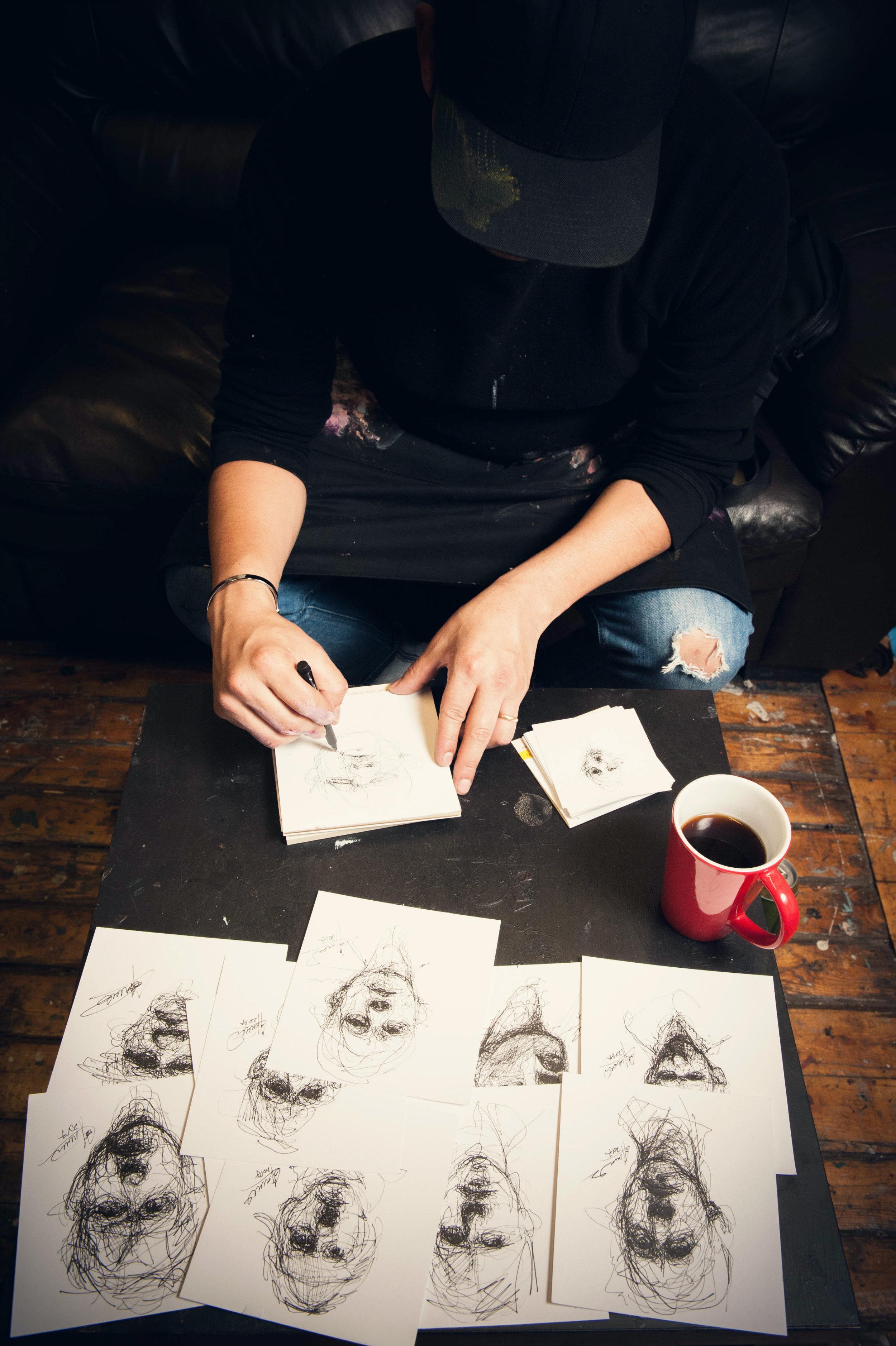 Drawing small scale sketches. Carlos Delgado in his studio in Toronto. Photo by Alex Usquiano.